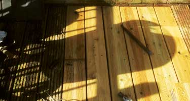 a photo of a completely finished rotten decking repair using the customers own decking boards that do not match the rest but it is a safe very cheap fix